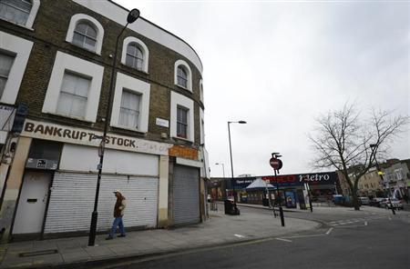 A man walks past a closed down shop in east London, January 25, 2013. REUTERS/Paul Hackett