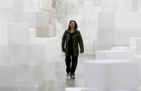 British artist Rachel Whiteread walks through her new installation entitled The Unilever Series: Rachel Whiteread at its unveiling in the Turbine Hall at the Tate Modern art gallery in London, October 10, 2005.