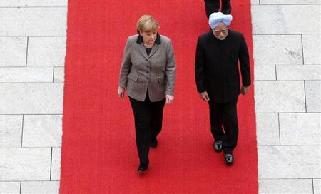 German Chancellor Angela Merkel and Indian Prime Minister Manmohan Singh review a guard of honour of the German armed forces upon his arrival at the Chancellery in Berlin, April 11, 2013. REUTERS/Fabrizio Bensch