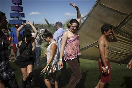 People dance on the final day of the Coachella Valley Music and Arts Festival in Indio, California April 15, 2012. REUTERS/David McNew