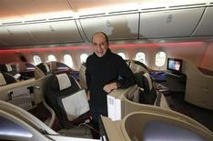 Qatar Airways CEO Akbar Al Baker poses for a photograph in the business class cabin of the new Boeing 787 Dreamliner after it arrived on it's inaugural flight to Heathrow Airport, west London December 13, 2012. REUTERS/Andrew Winning