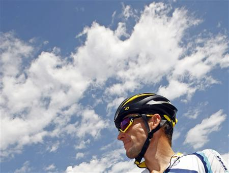 Astana rider Lance Armstrong of the U.S. awaits the start of the 19th stage of the 96th Tour de France cycling race between Bourgoin-Jailleu and Aubenas, July 24, 2009. REUTERS/Bogdan Cristel