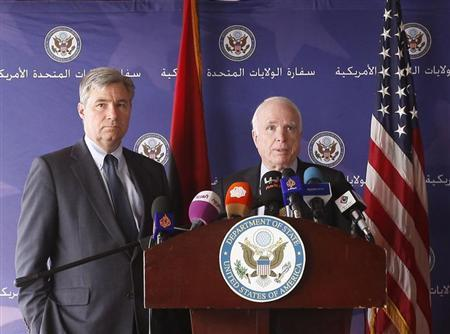 U.S. Senator John McCain (R) speaks during a news conference next to with Senator Sheldon Whitehouse after his meeting with Libyan officials in Tripoli, April 4, 2013. REUTERS/Ismail Zitouni