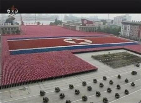 North Korean soldiers form a giant North Korean flag during a military parade in Pyongyang's central square in this still image taken from video September 9, 2011 marking the 63rd anniversary of the state's founding. REUTERS/KRT via Reuters TV/Files