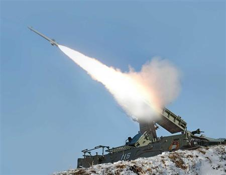 A rocket is fired during a drill of drone planes assaulting targets and a firing drill of self-propelled flak rocket destroying ''enemy'' cruise missiles coming in attack in low altitude, conducted by the air force and air defence artillery units of the Korean People's Army in an undisclosed location in this picture released by the North's official KCNA news agency in Pyongyang March 20, 2013. REUTERS/KCNA