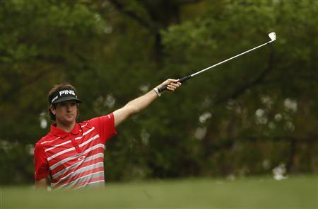 Defending champion Bubba Watson of the U.S. gestures after hitting his tee shot on the fourth hole during first round play in the 2013 Masters golf tournament at the Augusta National Golf Club in Augusta, Georgia, April 11, 2013. REUTERS/Mark Blinch