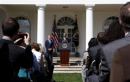 U.S. President Barack Obama talks about the Fiscal Year 2014 Budget while standing next to acting Director of Office of Management and Budget Jeffrey Zients in the Rose Garden at the White House in Washington, April 10, 2013. REUTERS/Larry Downing