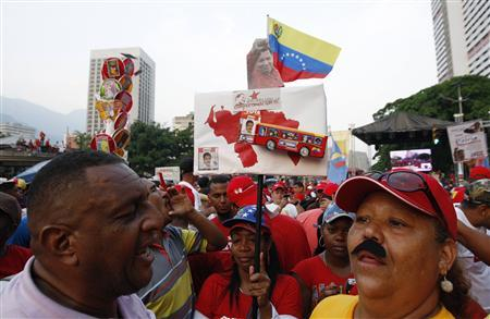 A supporter of Venezuela's acting President and presidential candidate Nicolas Maduro wearing a fake moustache sings slogans during Maduro's closing campaign rally in Caracas April 11, 2013. REUTERS-Edwin Montilva