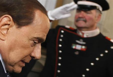 Italy's former Prime Minister Silvio Berlusconi leaves after a meeting with Italian President Giorgio Napolitano at Quirinale palace in Rome March 29, 2013. REUTERS/Stefano Rellandini