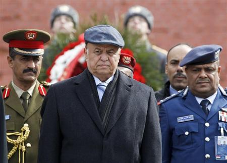 Yemen's President Abd-Rabbu Mansour Hadi (C) watches honour guards pass by after a wreath laying ceremony at the Tomb of the Unknown Soldier near Moscow's Kremlin walls, April 2, 2013. REUTERS/Sergei Karpukhin