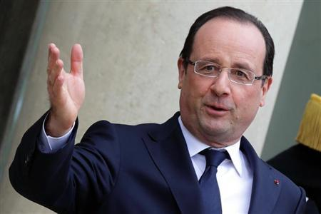 French President Francois Hollande stands on the steps of the Elysee Palace in Paris, April 11, 2013. REUTERS/Philippe Wojazer