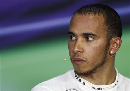 Third-placed Mercedes Formula One driver Lewis Hamilton of Britain attends a post race news conference after the Malaysian F1 Grand Prix at Sepang International Circuit outside Kuala Lumpur, March 24, 2013. REUTERS/Samsul Said