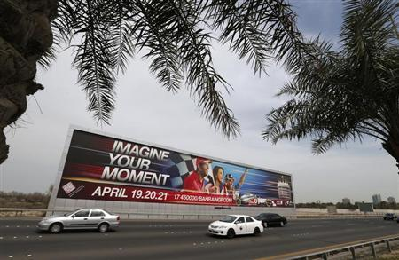 Vehicles travel past a large Bahrain Formula One advertising billboard on main highway leading to Bahrain Internaitonal Circuit, in Manama April 9, 2013. Bahrain will host The F1 grand prix from April 19 to April 21. REUTERS/Hamad I Mohammed