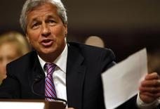 JP Morgan Chase and Company CEO Jamie Dimon answers a question at the U.S. Senate hearing on Capitol Hill in Washington in this file photo taken June 13, 2012. JPMorgan Chase & Co posted an increase in first-quarter profits on Friday as the biggest U.S. bank benefited from lower expenses. REUTERS/Larry Downing/Files
