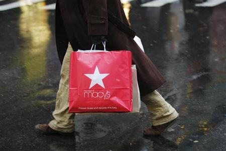 A shopper walks on a street in New York, December 26, 2012. REUTERS/Eduardo Munoz