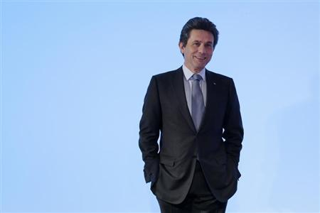 Henri de Castries, Chief Executive of Europe's second-biggest insurer Axa, poses before the company's 2012 annual results presentation in Paris February 21, 2013. REUTERS/Jacky Naegelen