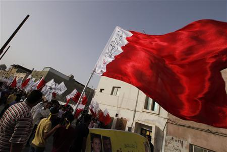 Protesters holding Bahraini flags with victory signs drawn on them participate in a 40th day (Arbaoon) funeral procession of Salah Abbas Habib in village of Bilad al-Qadeem west of Manama, June 2, 2012. REUTERS/Hamad I Mohammed