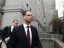 Former Credit Suisse Group AG trader Kareem Serageldin departs Manhattan Federal Court with his lawyer Sean Casey (L) in New York, April 12, 2013. Serageldin, the Swiss bank's former global head of structured credit, pleaded guilty to a conspiracy charge in a U.S. criminal case relating to the alleged inflation of subprime mortgage bond prices. REUTERS/Brendan McDermid
