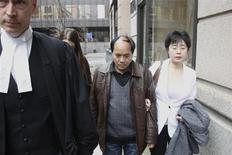 Diran Lin (C), father of victim Jun Lin, leaves the morning preliminary hearing of suspect Luka Rocco Magnotta in Montreal, March 12, 2013. REUTERS/Christinne Muschi