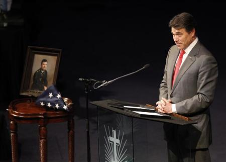 Texas Governor Rick Perry speaks at a memorial service for Kaufman County district attorney Mike McLelland and his wife Cynthia in Sunnyvale, Texas April 4, 2013. REUTERS/Mike Stone