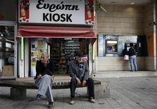 A Nicosie. Chypre a annoncé vendredi que l'augmentation du coût de son plan de sauvetage à environ 23 milliards d'euros n'entraînerait pas de coût supplémentaire pour les déposants des banques du pays. /Photo prise le 29 mars 2013/REUTERS/Yorgos Karahalis
