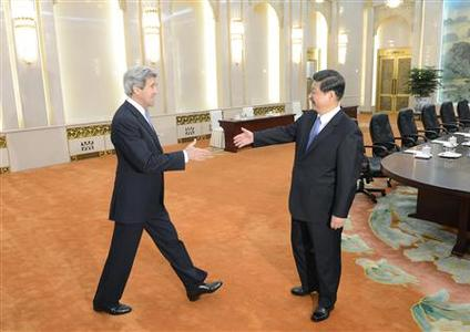 U.S. Secretary of State John Kerry (L) shakes hands with Chinese President Xi Jinping before their meeting at the Great Hall of the People in Beijing April 13, 2013. REUTERS-Yohsuke Mizuno-Pool