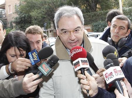 Italian Serie A president Maurizio Beretta (C) talks to reporters as he arrives to attend a meeting in Rome December 7, 2010. REUTERS/Tony Gentile