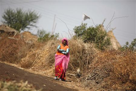Jeandi, 40, stands outside her house made of bushes, at a camp for freed bonded labourers on the outskirts of the city of Hyderabad in Pakistan's Sindh province February 4, 2013. REUTERS/Akhtar Soomro