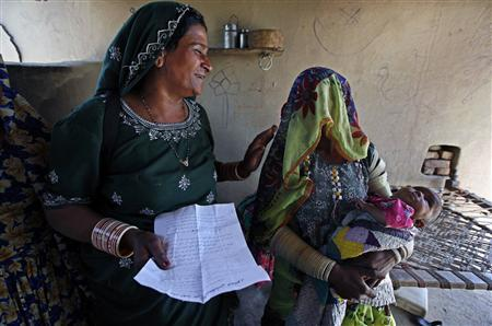 Veero Kolhi (L), a freed bonded labourer turned election candidate, talks to her supporter during an election campaign at a camp for freed bonded labourers,on the outskirts of the city of Hyderabad in Pakistan's Sindh province April 4, 2013. REUTERS/Akhtar Soomro