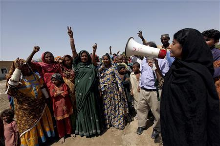 Veero Kolhi, a freed bonded labourer turned election candidate, along with her supporters makes a victory sign as they chant slogans during an election campaign on the outskirts of the city of Hyderabad in Pakistan's Sindh province April 5, 2013. REUTERS/Akhtar Soomro