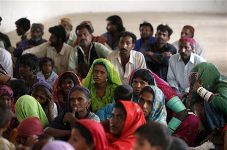 Supporters of Veero Kolhi, a freed bonded labourer turned election candidate, listen to her speech during an election campaign on the outskirts of the city of Hyderabad in Pakistan's Sindh province April 5, 2013. REUTERS.Akhtar Soomro