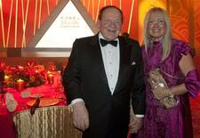 Las Vegas Sands Chairman and CEO Sheldon Adelson and his wife Miriam Ochsorn (R) pose for a photo during the opening ceremony of Sheraton Macao hotel at Sands Cotai Central in Macau September 20, 2012. REUTERS/Tyrone Siu
