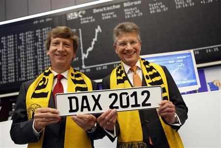 Elmar Degenhart (R), CEO of Germany's Continental AG, poses with CFO Wolfgang Schaefer for a picture in front of the DAX board at the Frankfurt stock exchange September 6, 2012. REUTERS/Alex Domanski