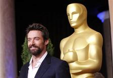 "Hugh Jackman, nominated for best actor for his role in ""Les Miserables"", arrives at the 85th Academy Awards nominees luncheon in Beverly Hills, California in this February 4, 2013, file photo. Officers arrested a woman for stalking after she wielded an electric razor while approaching Australian actor Hugh Jackman at his New York City gym, police said on April 14, 2013. REUTERS/Mario Anzuoni/Files"