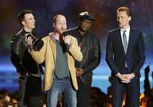 "Director Joss Whedon accepts the award for Best Fight for ""The Avengers"" with cast members Chris Evans (L), Samuel L. Jackson and Tom Hiddleston (R) at the 2013 MTV Movie Awards in Culver City, California April 14, 2013. REUTERS/Danny Moloshok"