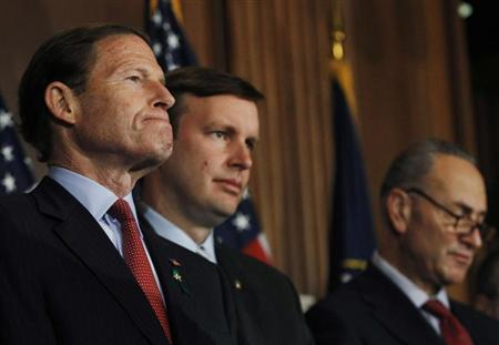 U.S. Senators Richard Blumenthal (D-CT) (L-R), Christopher Murphy (D-CT) and Charles Schumer (D-NY) meet with the family members of gun violence victims in Washington April 11, 2013. REUTERS/Gary Cameron