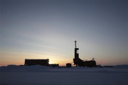 The sun sets behind an oil drilling rig in Prudhoe Bay, Alaska on March 17, 2011. REUTERS/Lucas Jackson