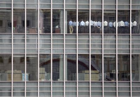 Staff stand in a meeting room at Lehman Brothers offices in the financial district of Canary Wharf in London in this September 11, 2008 file photo. REUTERS/Kevin Coombs