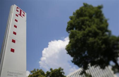The logo of Deutsche Telekom AG is seen outside the company's headquarter in Bonn May 24, 2012. REUTERS/Wolfgang Rattay