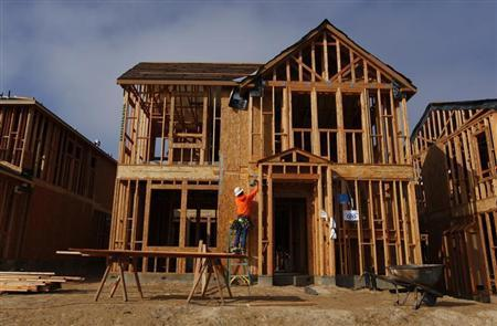 A construction worker is seen working while building single family homes in San Diego, California March 25, 2013. REUTERS/Mike Blake