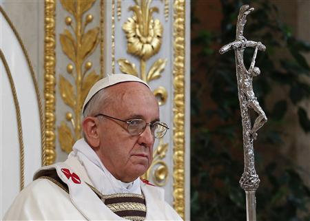 Pope Francis holds a cross as he leads a solemn mass at Saint Paul's Basilica in Rome April 14, 2013. REUTERS/Max Rossi
