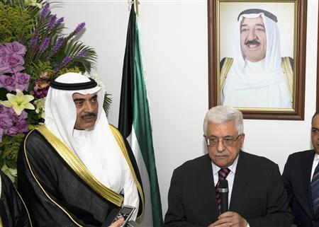 Palestinian President Mahmoud Abbas (2nd L) and Kuwaiti Deputy Prime Minister and Minister of Foreign Affairs Sheikh Sabah al Khalid al-Sabah speak after a flag-raising ceremony at the new Palestinian Embassy in Bayan April 15, 2013. REUTERS/Stephanie McGehee