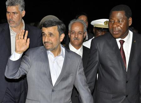 Iranian President Mahmoud Ahmadinejad (2nd L) waves next to Benin's President Thomas Boni Yayi (R) as he arrives in Cotonou April 14, 2013. REUTERS/Charles Placide