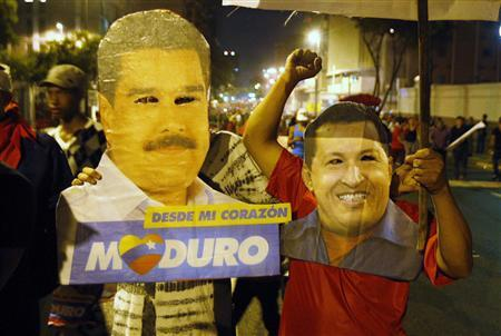 Supporters of Venezuelan presidential candidate Nicolas Maduro celebrate with masks of Maduro (L) and late Venezuelan President Hugo Chavez, after the official results gave Maduro a victory in the balloting, in Caracas April 14, 2013. REUTERS/Edwin Montilva