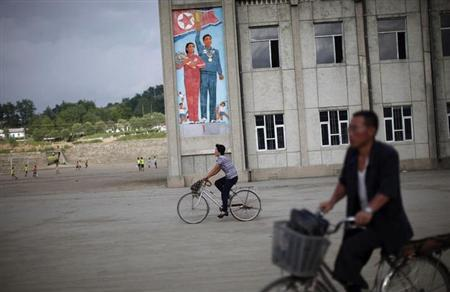 People ride their bicycles in Rason city, northeast of Pyongyang, August 29, 2011. REUTERS/Carlos Barria/Files