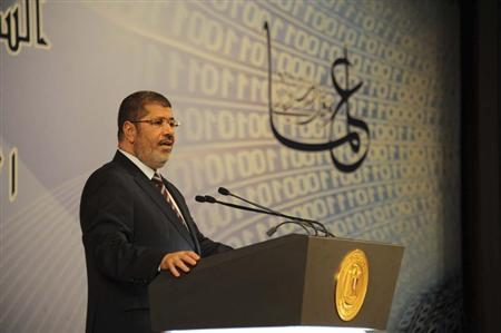 Egypt's President Mohamed Mursi speaks during an event marking Science Day in Cairo April 11, 2013 in this picture provided by the Egyptian Presidency. REUTERS/Egyptian Presidency/Handout