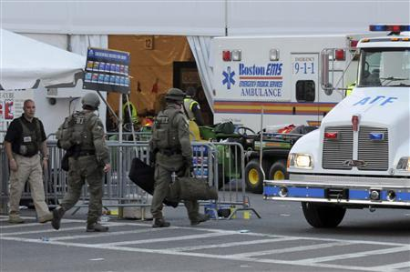 Agents from several federal agencies including the FBI and ATF arrive on scene after explosions near the finish line of the Boston Marathon in Boston, Massachusetts April 15, 2013. REUTERS-Neal Hamberg