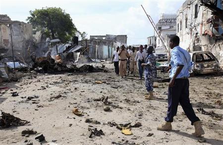 Somali policemen view the scene of a deadly blast in Mogadishu April 14, 2013. REUTERS/Omar Faruk