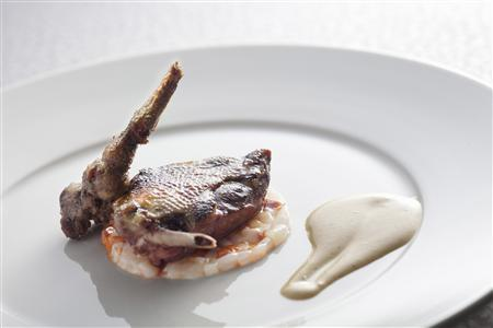 A dish named One Side Grilled Pigeon with Brunoise of Chorizo and Squid by chef Philippe Leveille is displayed at L'Altro in Hong Kong September 10, 2012. With his newly-opened restaurant in Hong Kong named L'Altro - ''the Other'' - Leveille, the two-starred Michelin chef at Miramonti L'altro in Brescia, Italy for more than a decade now. is discovering new ways to adapt and innovate his cuisine in an Asian setting. REUTERS/L'altro, Hong Kong/Handout