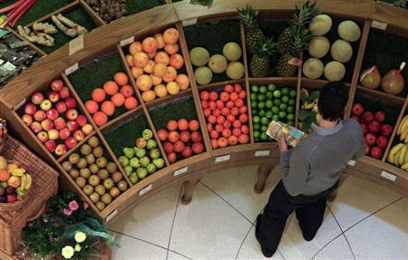 A customer looks at fruit in a store in central London April 12, 2011. REUTERS/Stefan Wermuth
